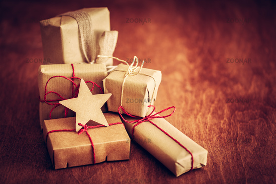Rustic retro gift, present boxes with tag. Christmas time, eco paper wrap.