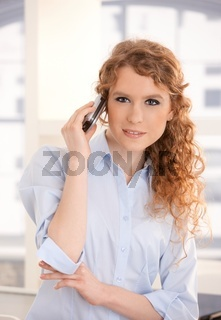 Portrait of pretty woman using mobile phone