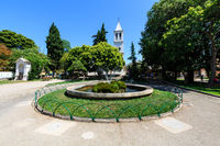 Fountains with Live Turtles and Small Church in Sibenik, Croatia
