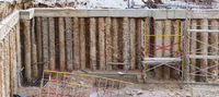 The pit of the new building under construction in the city is fortified with concrete piles