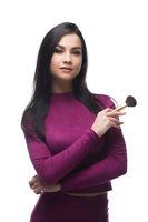 Pretty brunette in sexy purple jersey blouse shot
