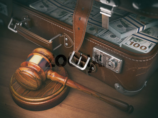 Gavel and suitacse full of money. Concept of corruption, business crime or paying an auction.