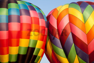 Hot air balloons bumping during inflation