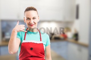 Private maid or housekeeper showing call me gesture