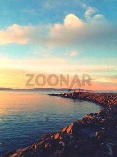orange toned sunset in Salthill, Galway