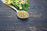 Thyme dry in spoon on black board