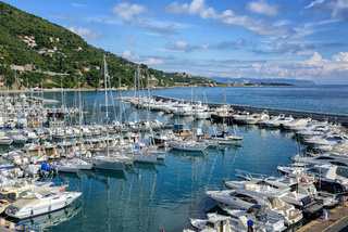 White yachts docked in port of Alassio on Riviera, Italy