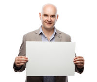 Happy bald man showing and displaying placard ready for your text or product
