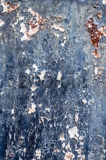 Rostiges Metall mit abblätternder blauer Farbe