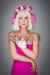 Beautiful girl in pink dress with floral head accessory