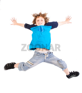 Attractive young kid jumping high, indoors