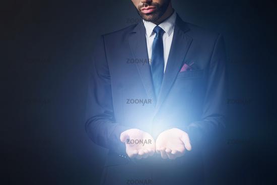 Light radiating from businessman hands