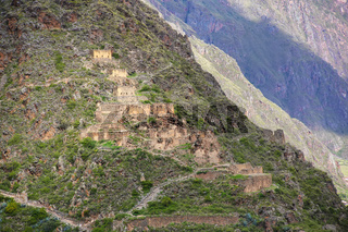 Inca storehouses on the hill surrounding Ollantaytambo, Peru