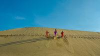 Minority Cham Girls on Sand Dune
