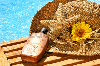 Summer straw hat with tanning lotion
