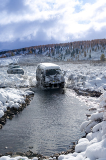 Winter off-road expedition.  Crossing through the ford.