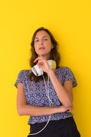 woman with headphones isolated on a yellow