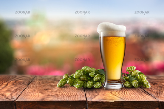 glass with Beer and hop on a wooden table