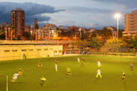 Football match at twilight