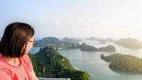 Woman on peak looking beautiful nature