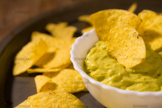 Closeup of salsa guacamole and nachos chips