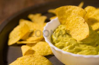 Closeup of salsa guacamole and nachos chips