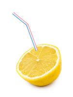 Lemon fruit and straw