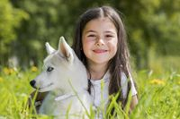 Little girl with husky puppy