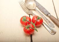 ripe cherry tomatoes over white wood