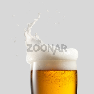 Close-up of cold beer with foam