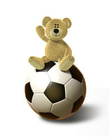 Nhi Bear sits on a big Soccer Ball