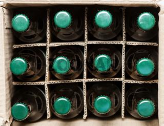 twelve beer bottles in cardboard box
