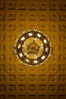Chandelier on decoarted ceiling