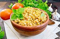 Barley porridge with basil on board