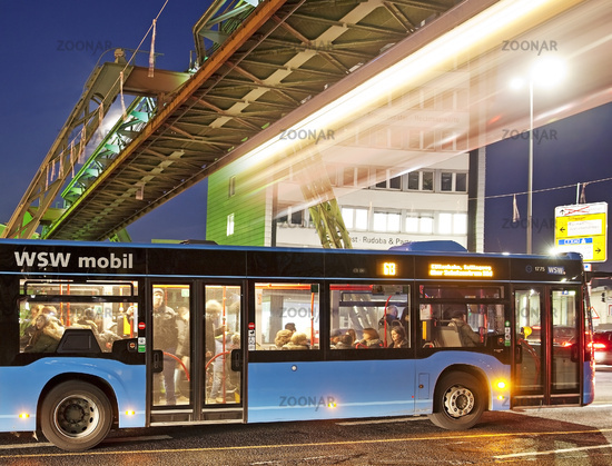 moving Wuppertal cable railway over a bus in the evening, Wuppertal,Bergisches Land, Germany, Europe