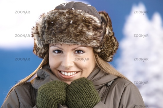 Pretty girl dressed up warm smiling freezing