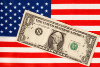 One Dollar bill over the USA flag