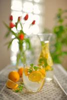 Fresh limes and lemonade on table