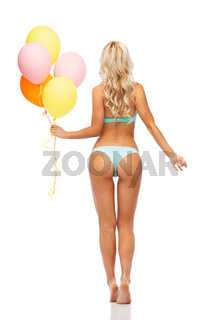 woman in bikini swimsuit with air balloons