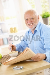 Portrait of older man at breakfast table