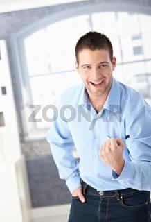 Successful man celebrating happily