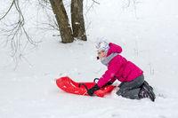 Girl enjoying a sleigh ride
