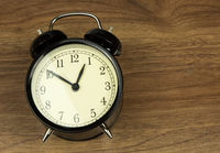 Old classic alarm clock, flat view
