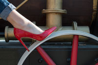 Girl in red patent leather shoes