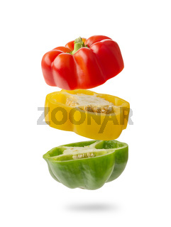 sliced and falling multicolored peppers