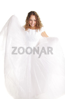 Smiling bride raising dress edges