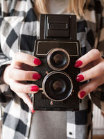 Female Holding a Vintage Camera