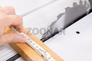 Carpenter working on an circular saw