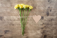 Yellow roses with heart shaped tag