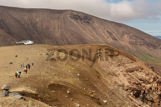 Tourist helicopter in Caldera volcano Ksudach. South Kamchatka Nature Park.